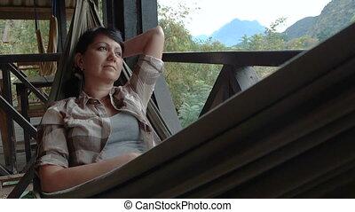 Woman relax in a hammock