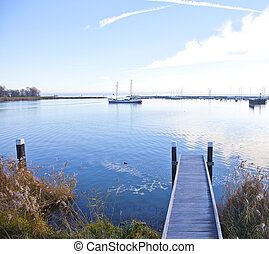 View at jetty with boat and lake in Enkhuizen, The...