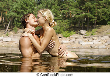 Love games on the beach - Young beautiful couple are kissing...