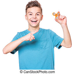 Teen boy with spinner on white