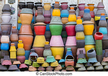 Colorful clay pots on the ground. Tourist art and craft...