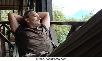 Man relax in a hammock