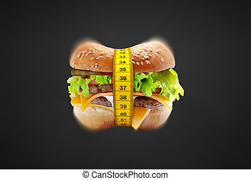 unhealthy food - big cheeseburger with meter diet concept