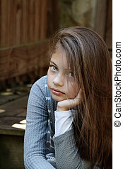 Beautiful Pre-Teen Girl - Young girl looking directly into...