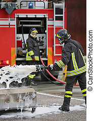 Firefighter training and fire extinguishing with foam and truck