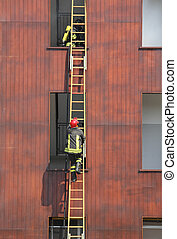 firefighters on the wooden ladder during firefighting in the...