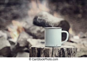 Vintage Cup of Coffee by a Campfire - Cup of hot steaming...