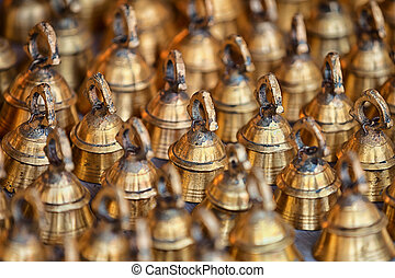 Large bells for cattle on the market counter. India, Pushkar...