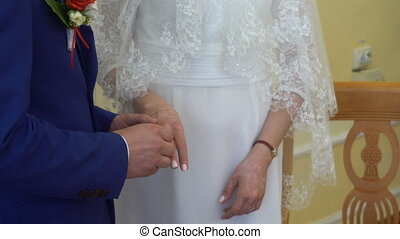 Two white people groom and bride exchange wedding rings