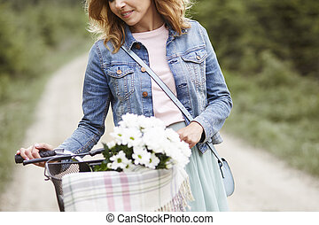 Close up of woman with bike