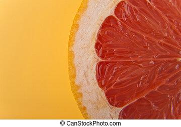 flesh is orange on yellow background close-up
