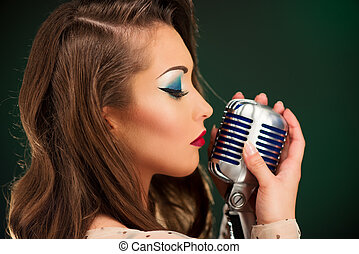 Retro Female Singer - A young pretty woman singer singing...