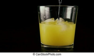 Slow mo. Juice with ice in a glass add vodka - Slow mo....