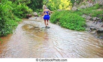 Backside View Little Girl Walks Barefoot in Stream -...