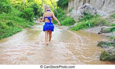 Closeup Little Girl Plays Barefoot in Stream - Cute blonde...
