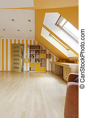 Attic decorated in sunny colors with wooden desk, bookcase...