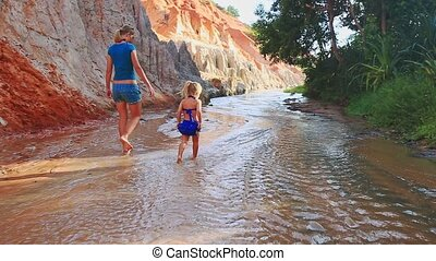 Closeup Mother Small Daughter in Blue Gambol Barefoot in...