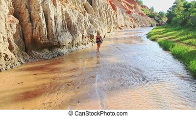 Small Girl Runs Plays in Stream Shallow Water
