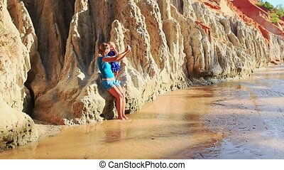Mother Small Daughter Sit on Cliff by Stream Make Selfie -...