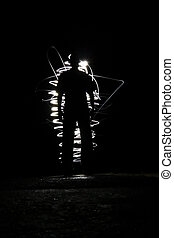 Man in the light - Silhouette of a man with a shining light...
