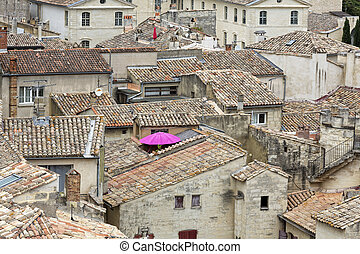 Looking over old tiled roofs of Uzes town in South France