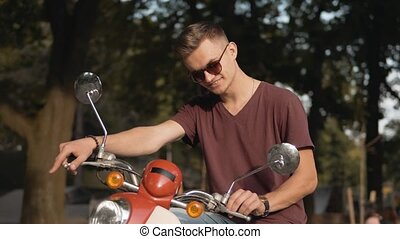 Portrait of Biker in the Park - Young attractive man wears...