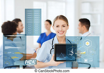 happy doctor with chart on tablet pc at hospital