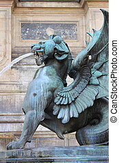 Winged lion in the Saint Michael fountain. Paris, France