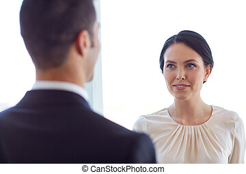 smiling business man and woman at office