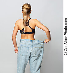 young slim sporty woman in oversize pants - fitness, diet,...
