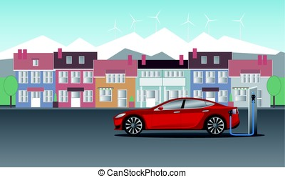 Electric car stands near the station and is charged against...