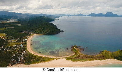 Aerial view beautiful beach on a tropical island....