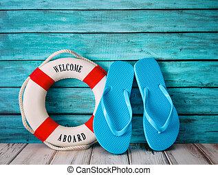 Blue flip flops sandals on wood