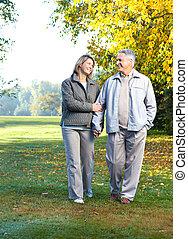 Happy elderly couple in love in park