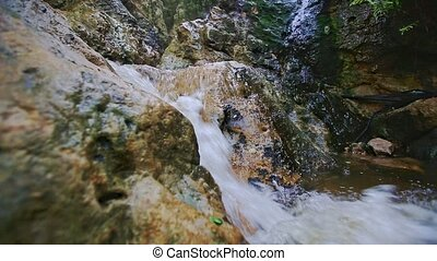 Closeup Small Foamy Mountain Waterfall Flows into River -...
