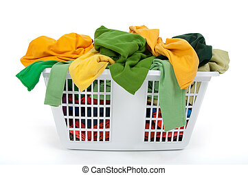 Colorful clothes in laundry basket. Green, yellow.