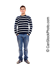 Young man standing firmly with hands in pockets - A portrait...