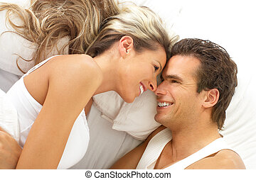 couple - Young happy couple in a bed