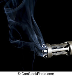 firearm smoke clearing - smoke rising from a flash hider on...