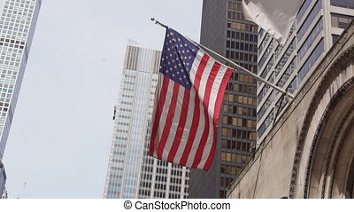 American flag against bright blue sky American flag against...