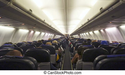 Interior of airplane with passengers on seats. - Moscow,...