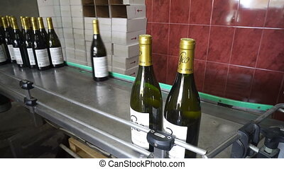 Bottling and sealing conveyor line at winery factory -...