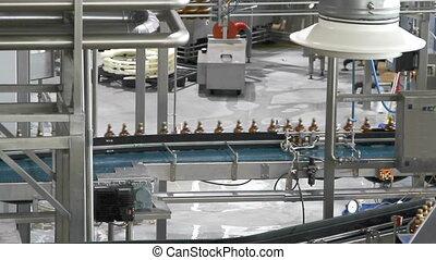 Plastic water bottles on conveyor or water bottling machine...