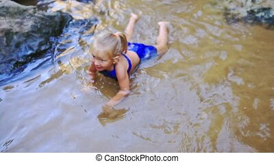 Little Blond Girl Tries to Swim in Shallow Pond - Little...