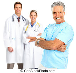 doctor and healthy elderly man - Smiling medical doctors...