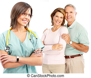 doctor and elderly couple - Smiling medical doctor with...