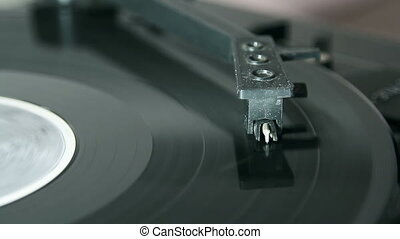 turntable with stylus running along a vinyl record