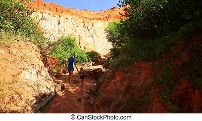 Mother Girl Walk on Dry Riverbed among Sunny and Shady Banks...