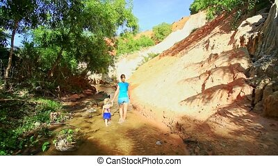 Mother Daughter Walk along Stream Pass Shady and Sunny Banks...