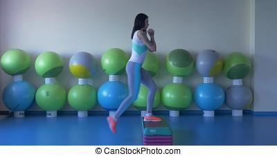 Girl doing exercises for legs in the fitness room. Girls do...